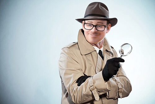 Retro detective man with mustache and hat. Holding magnifying glass. Studio shot.; Shutterstock ID 143708851; PO: Crispin Porter + Bogusky Scandinavia AB; Job: Boxe0061 ; Client: Boxer